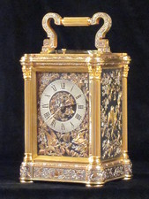 A exceptionally fine carriage clock in muti-coloured relief work