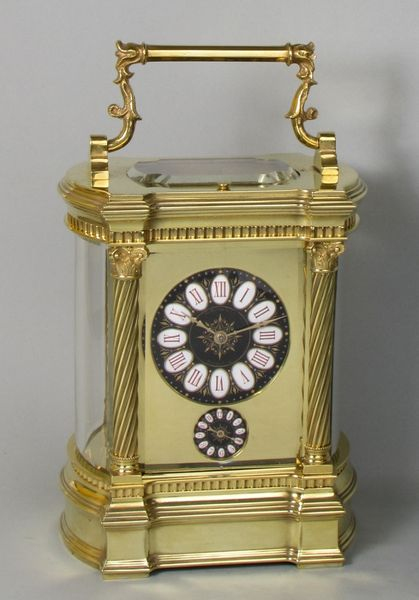 Bowed side French carriage clock with black dial