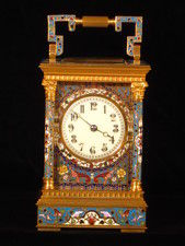 A fairly large champleve enamel carriage gong striking carriage clock