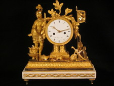 A fine fire-gilt mantel clock featuring a roman soldier and weapons.