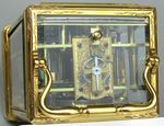 Early carriage clock with unusual escapement. (France)