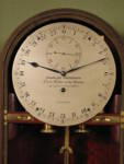 Miniature wall regulator with 24 hour dial (England)